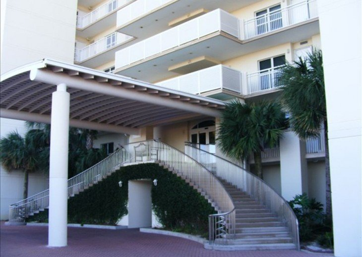 Front of Belle Mer. Unload here, go through middle door for carts and elevators