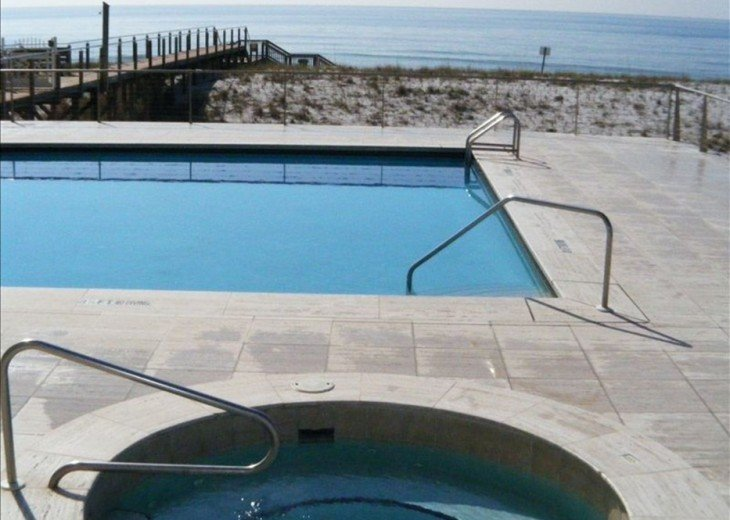 Hot tub, pool, and walkway over dunes to beach