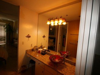 Dressing area has walk-in closet, granite, vessel sink and sit-down makeup area