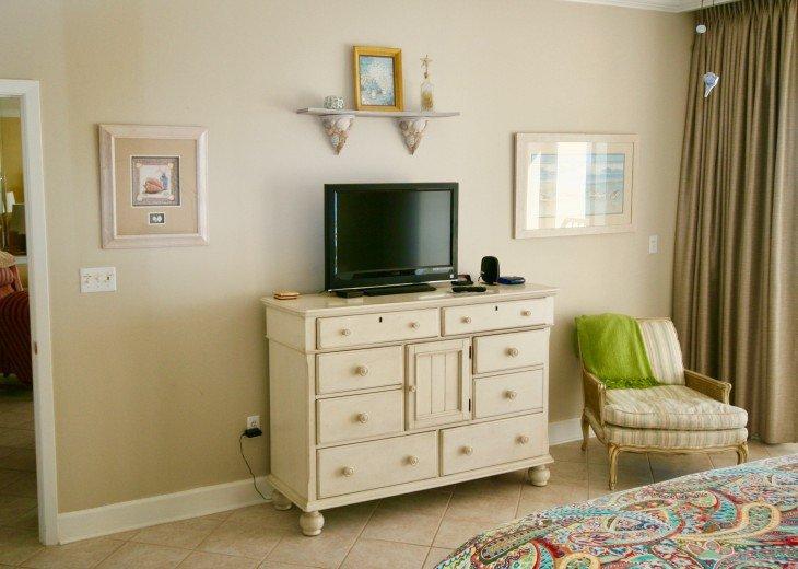 Master bedroom has nice size flat screen tv