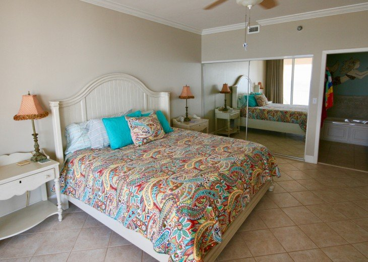 Another view of king bed and spacious closet in master bedroom
