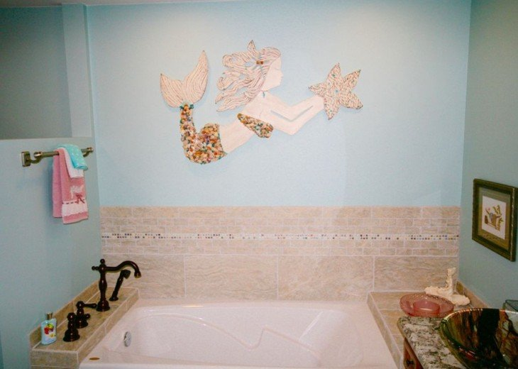 Air jetted master bath tub. Beautiful mermaid has shells from Navarre Beach