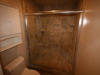 2nd bathroom has separate room with walk-in shower with a corner bench