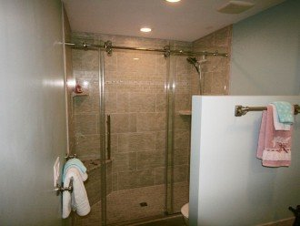 Large walk in shower and 1-piece toilet in master bath
