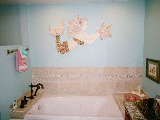 Air jetted master bath tub. Beautiful mermaid has shells from Navarre Beach