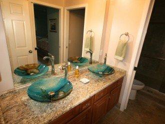 2nd bathroom has 2 vessel sinks and granite countertop