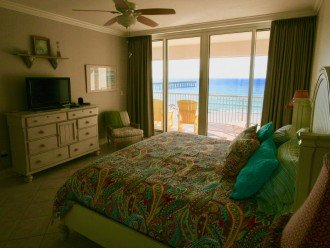 Spacious master bedroom has king bed and black-out drapes.