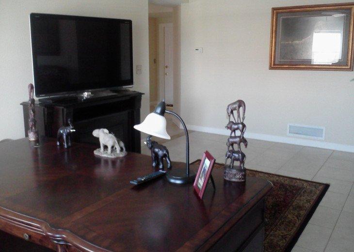 Desk & Large Flat screen TV in Bonus room