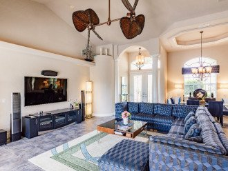 """Living area with 75"""" 4K TV and Martin Logan Sound System"""