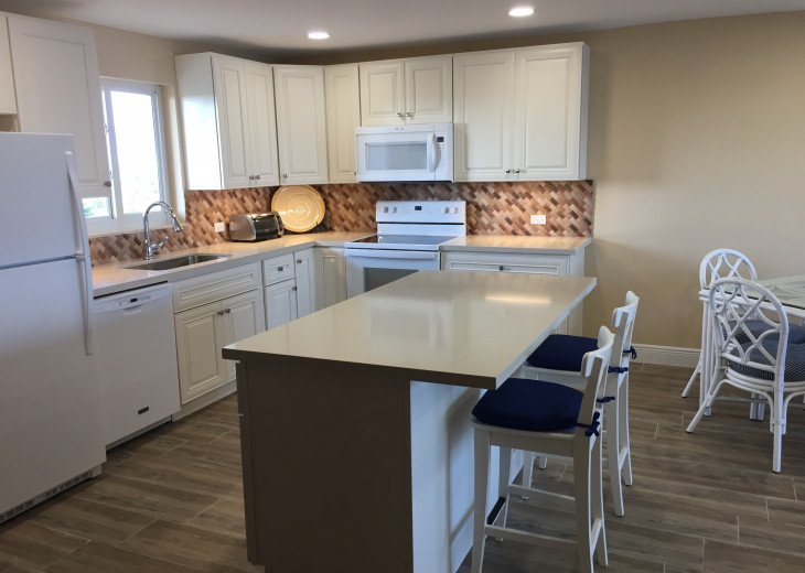 All new kitchen with quartz countertops and all new appliances