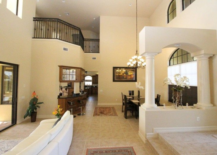 Grand entrance with two story high ceilings overlooking the pool and canal