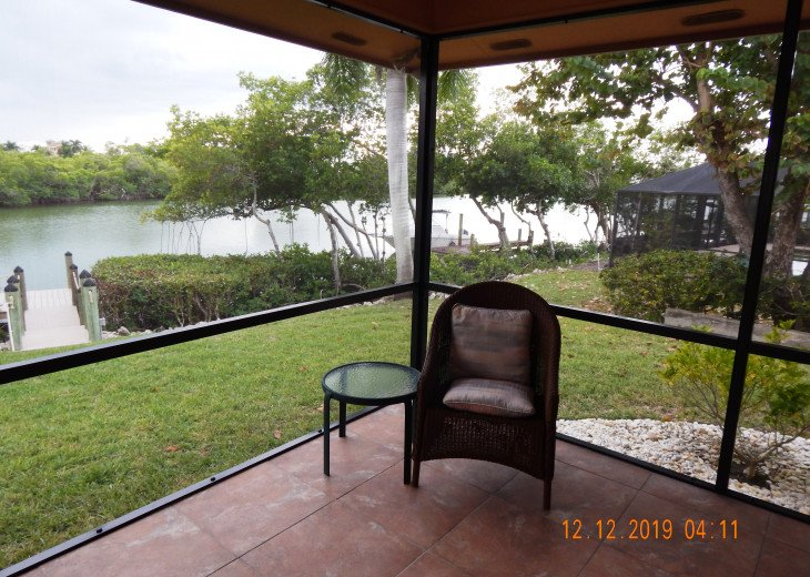 lanai and view of private boat dock and Estero Bay