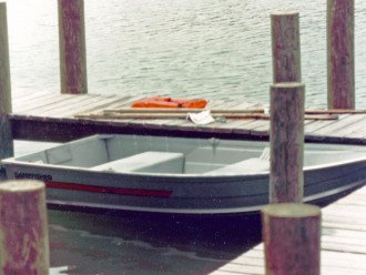 private boat with oars and life vests