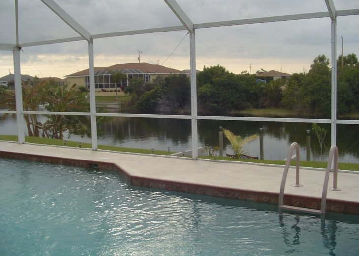 View from the lanai of the pool and dock