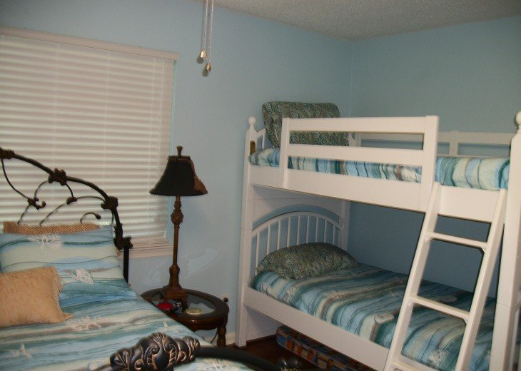 Second bedroom with queen and bunkbeds, also TV