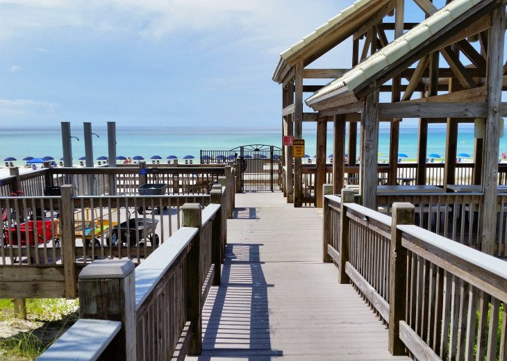 Private beach and pavilion w/ restrooms, showers, bar-n-grill and beach service