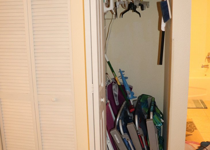 Hall closet with at least 2 beach chairs for guests to use