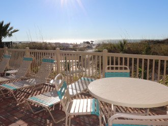 New furniture on pool patio that overlooks beach.
