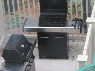 2 gas grills poolside