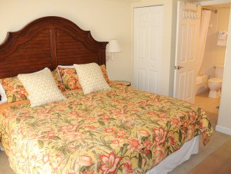 master bedroom with king tempurpedic mattress and on-suite bathroom
