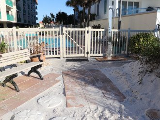 walkway from beach to pool with new bench and new shower