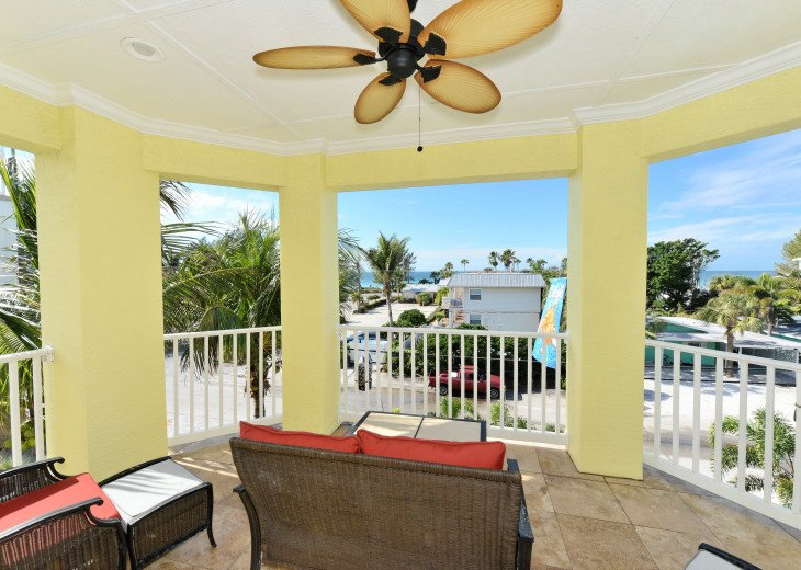 Master Suite Veranda has seating for guests to relax and watch sunsets!