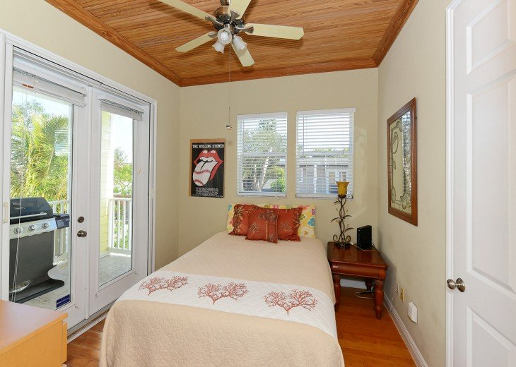 FIRST FLOOR QUEEN BEDROOM WITH BAMBOO FLOORING AND CEILING.
