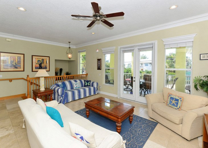 OPEN CONCEPT LIVING WITH ACCESS TO KITCHEN AND VERANDA.