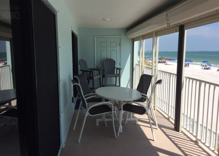 Large balcony with high chairs and dining table with 4 chairs ...