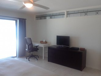 In the master, TV for your entertainment with a little office area if needed