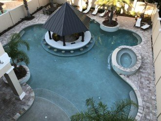 WOW....100,000 GALLON SALTWATER POOL WITH RESORT STYLE SWIM UP BAR