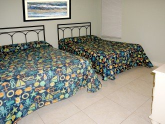 2 full beds - connects to hall bathroom