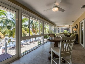 Beautifully remodeled coastal chic 3 bedroom 2 bath home with enclosed Florida R #1