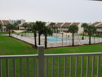 View of grounds and pool from patio