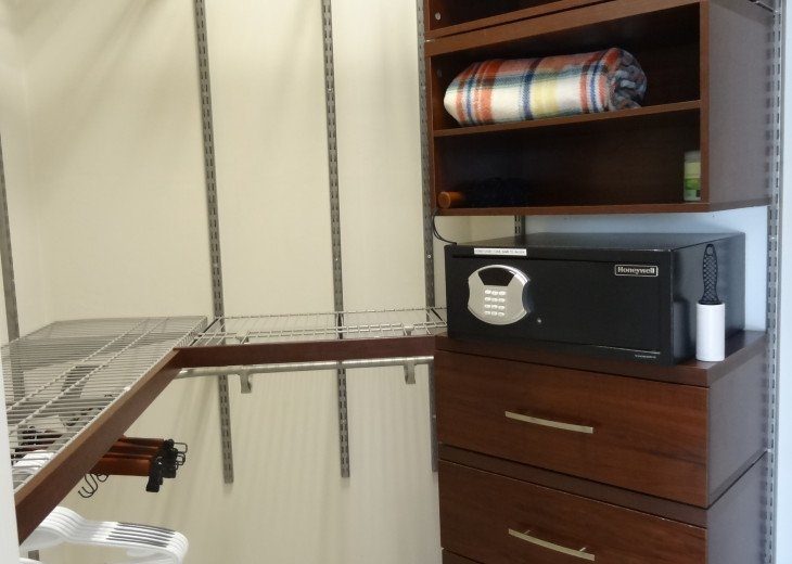 Master bedroom walk-in closet with a safe