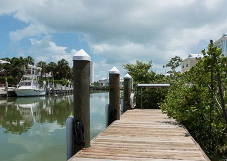 New 4/3, Canal Front, Private Dock, Neighborhood Beach, Hot Tub, Kayaks & More! #24