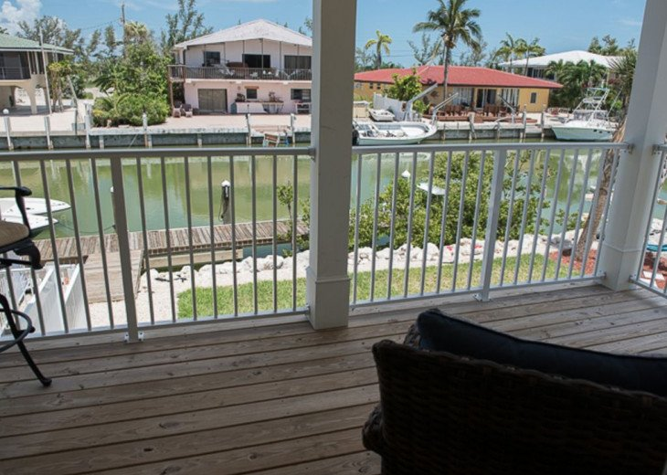 New 4/3, Canal Front, Private Dock, Neighborhood Beach, Hot Tub, Kayaks & More! #11