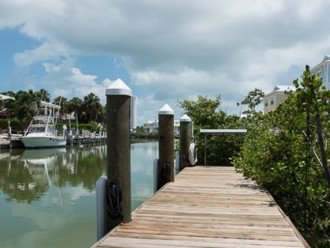 New 4/3, Canal Front, Private Dock, Neighborhood Beach, Hot Tub, Kayaks & More! #1