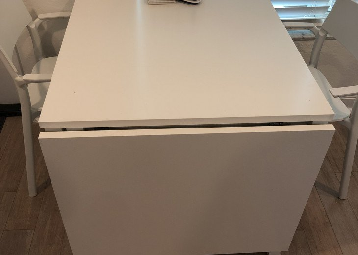 Desk converts to dining table for 4!