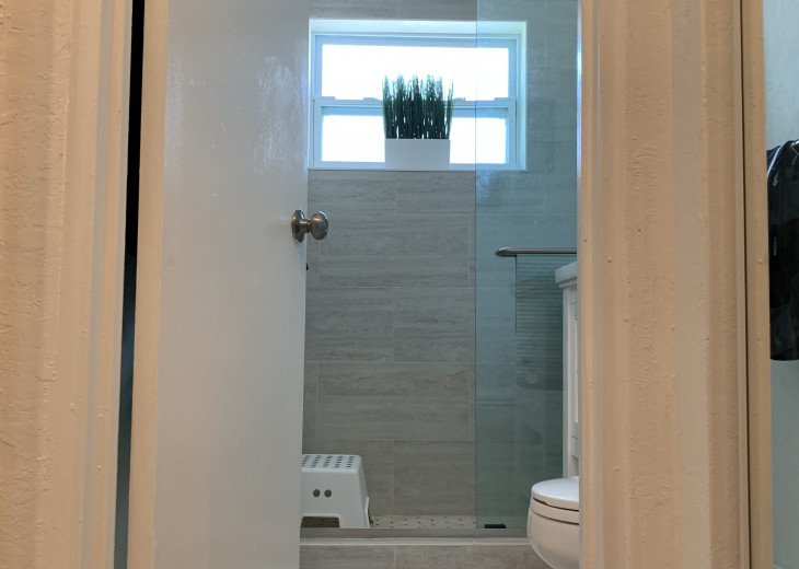 New modern spotless bathroom with step-in shower