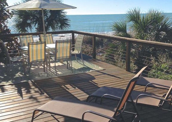 Dine, relax and sunbathe on the 'private rear deck' with gorgeous Gulf views