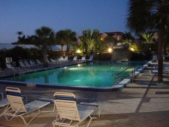Our large geo-thermal heated pool as seen at night. Hot Tub to the left