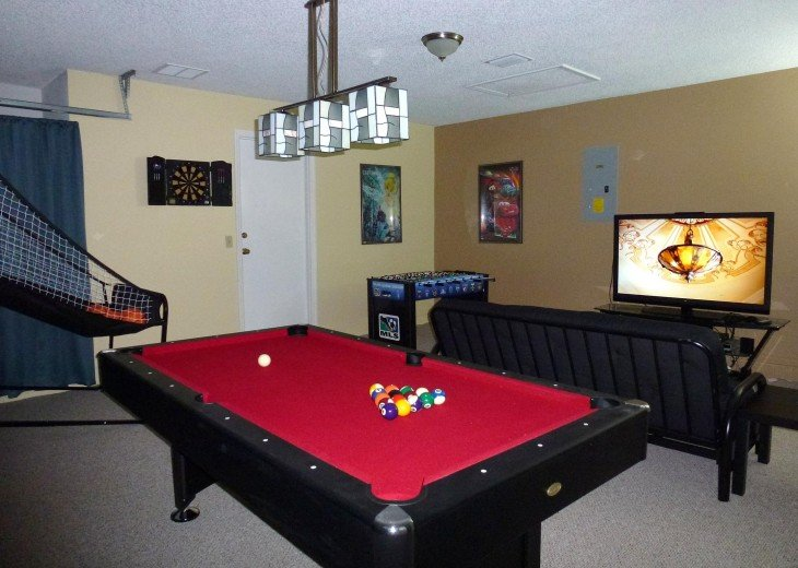 Game Room With Pool Table and Large TV