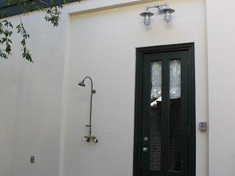 back door with outdoor shower