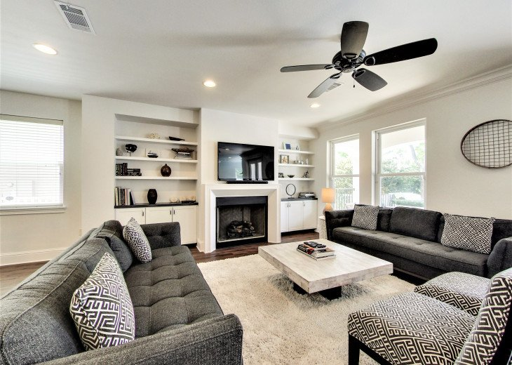 Bright and Open Living Area with Fireplace and Flat Screen TV