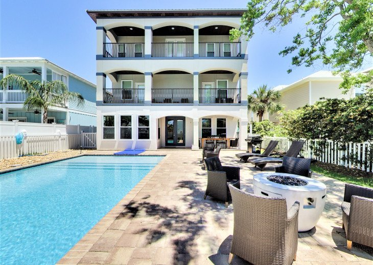 Luxurious Family Matters Retreat Sunny Pool Area, Outdoor Dining, and Play-set