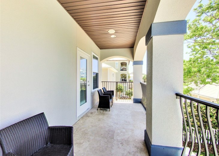 2nd floor spacious covered porch overlooking pool area