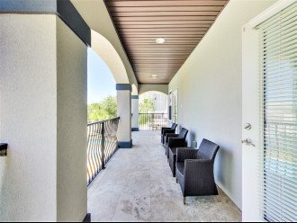 3rd floor covered porch overlooking pool area to relax and unwind