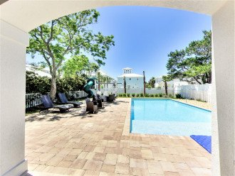 Expansive pool with covered Outdoor Dining Area with Grill