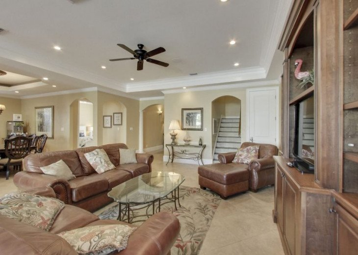 Beautiful Open Living Area feat. Large Flat-Screen and Plush Leather Couches